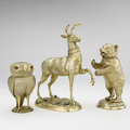 Ornate gold cups in the form of an owl, stag and a bear