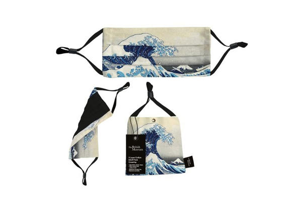 A facemask with a design depicting a large blue and white wave towering high above the view of Mount Fuji in the distance