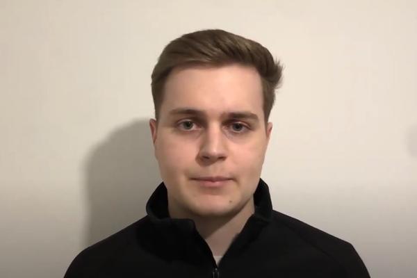 A man speaks to a webcam