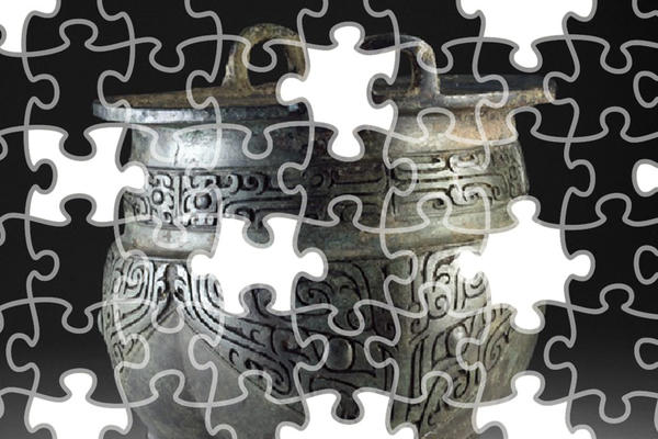 Jigsaw puzzle version of a decorated Chinese vessel