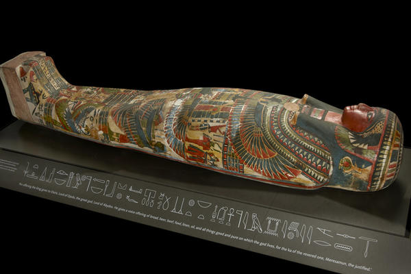 Mummy decorated with colourful artwork and hieroglyphs