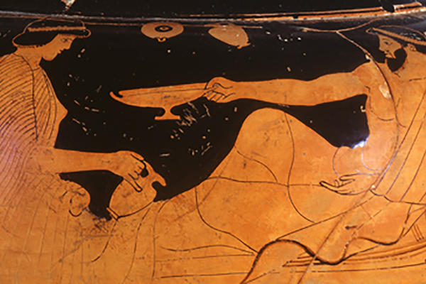 Red figure Greek pot depicting a reclining figure