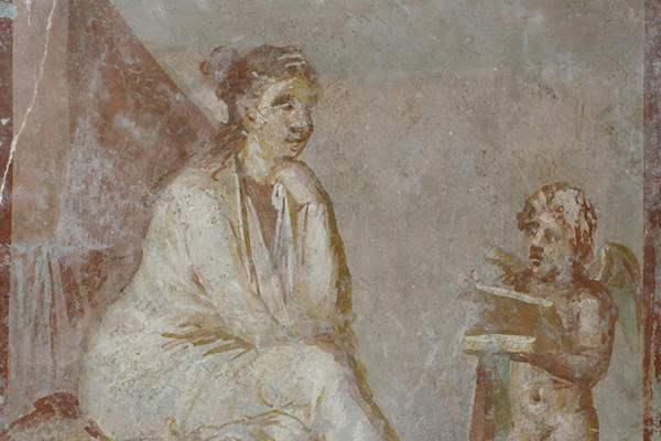 Fresco of a woman seated in contemplation next to a winged cupid holding a box