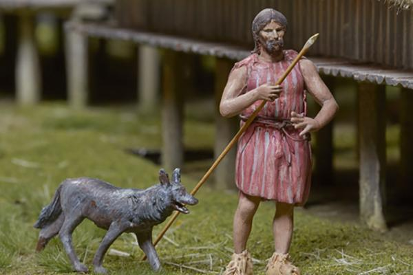na 73 19 neolithic lake village model man with spear and a dog