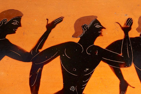 Runners on an orange ancient Greek pot