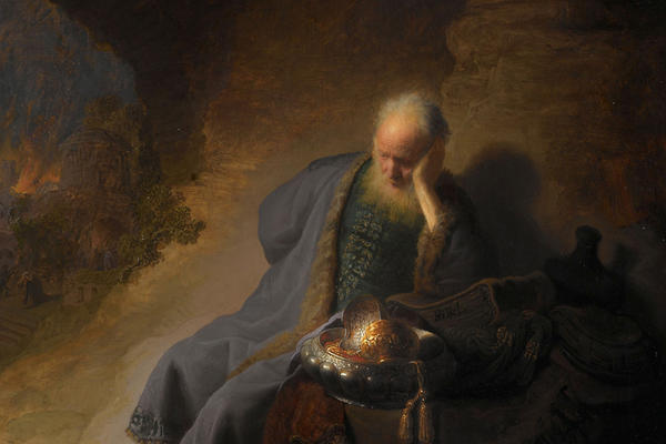 A painting of a old man in a blue robe resting in a cave.