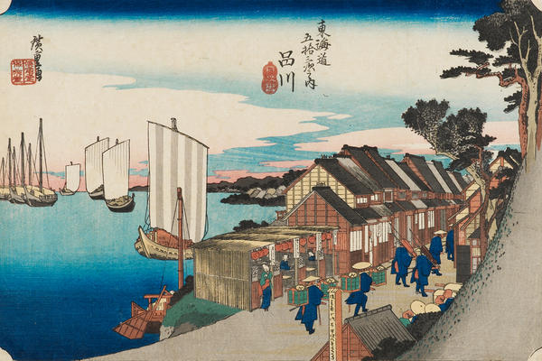 A woodblock print depicting boats in a harbour and people by buildings