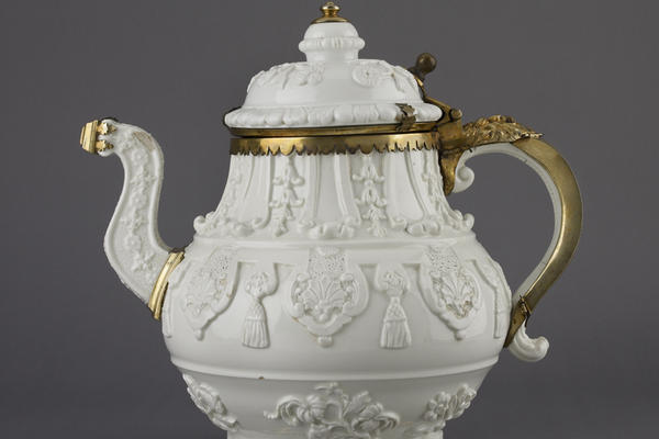 Ornate gold and white coffee pot