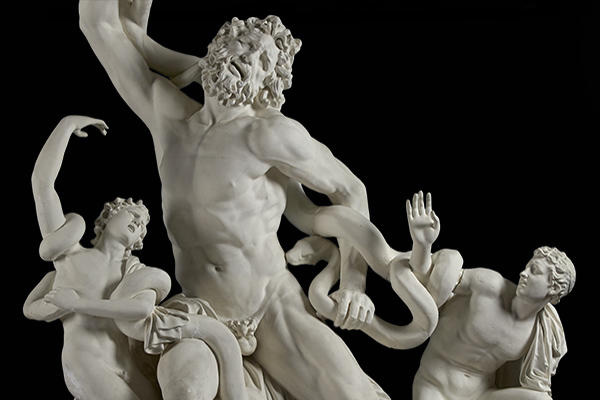 White cast of marble sculpture, depicting Laocoön and sons fighting snakes.