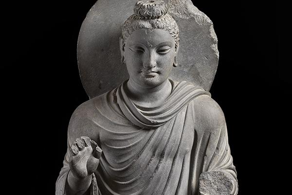 Grey stone statue of the buddha.