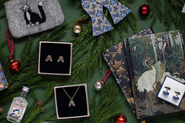 A selection of gifts including notebooks, jewellery and cufflinks