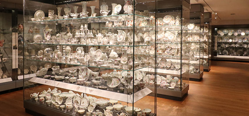 Gallery with display cases full of ceramics