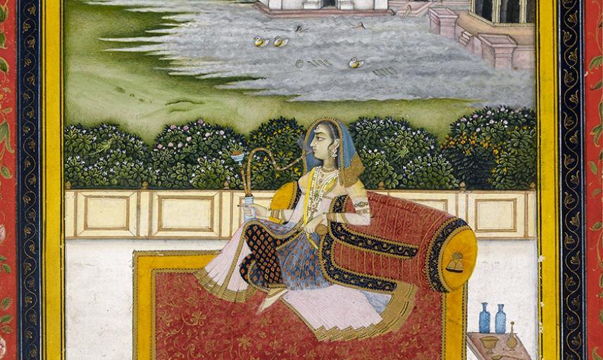 A lady smoking a hookah on a terrace by a lake