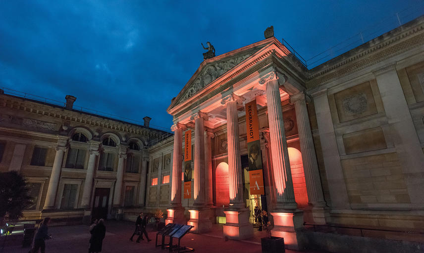Photo of the Ashmolean Forecourt at Night with Rembrandt Banners