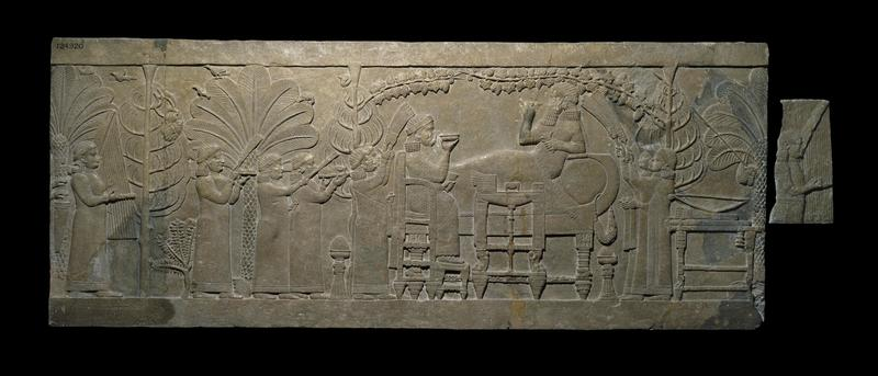 Gypsum relief; King Ashurbanipal reclines, feasting, while the head of his enemy, Teumman, King of Elam, hangs in the trees