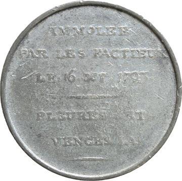white metal medallion
