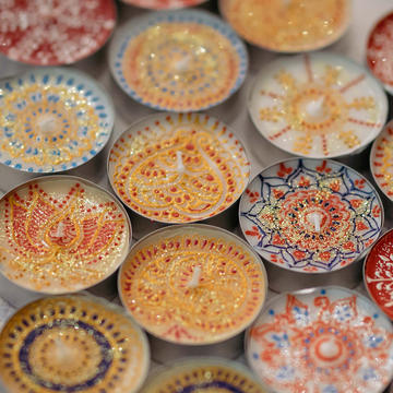 Tea lights painted with colourful patterns