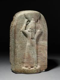 Stone stela of Ashurbanipal: the king is shown with a ritual basket of earth on his head, c.668-655 BCE