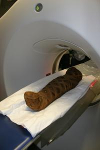 Egyptian child mummy (died between AD 80 - 120) entering CT scanner