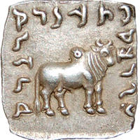 Square-shaped silver coin with engraving of a ram and scripture around the edges